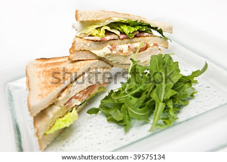 Grilled chicken and bacon club sandwich - stock photo