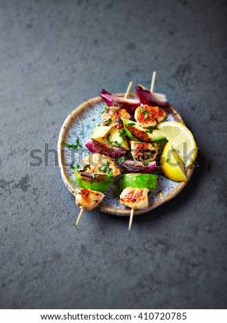 Grilled Chicken, Avocado and Red Onion Skewers  - stock photo