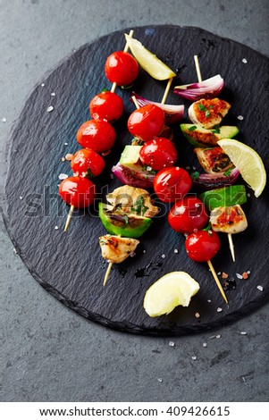 Grilled Chicken, Avocado, Zucchini and Cherry Tomato Skewers  - stock photo