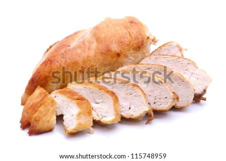 Grilled chicken breast on white ground - stock photo