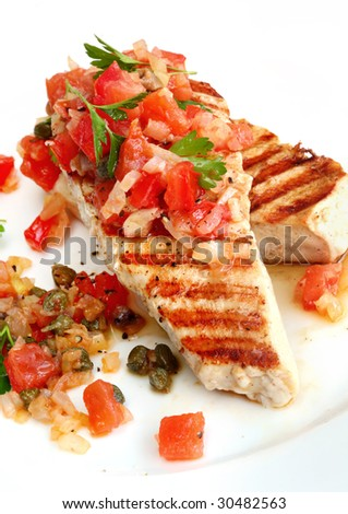 Grilled chicken breast with a salsa of tomato, onion, caper and parsley.