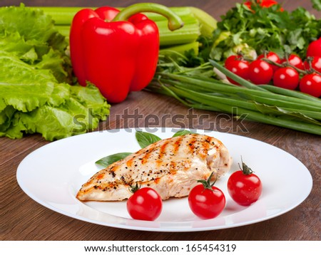 Grilled chicken breast with fresh vegetables  - stock photo