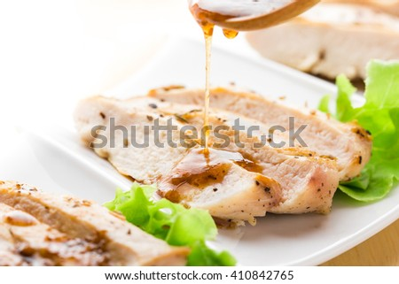 Grilled chicken breast with mixed vegetables and spicy on table. - stock photo