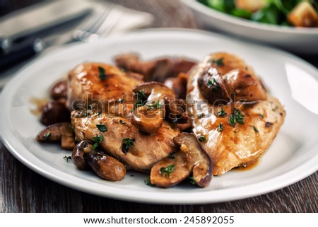 Grilled chicken breast with mushrooms - stock photo