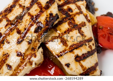 Grilled chicken breast with paprika. Macro. Can be used as a whole background. - stock photo