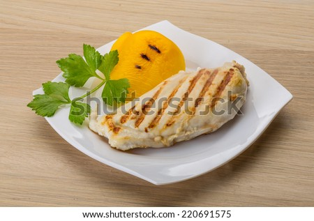 Grilled chicken breast with pepper and herbs