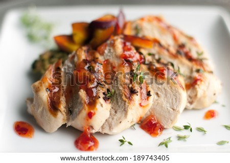 Grilled chicken breast with polenta and fresh vegetables - stock photo