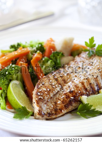 Grilled chicken breast with steamed vegetables.  Delicious, low fat eating.