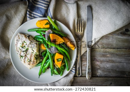 Grilled chicken breast with vegetables - stock photo