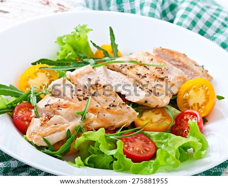 Grilled chicken breasts and fresh salad in white plate - stock photo