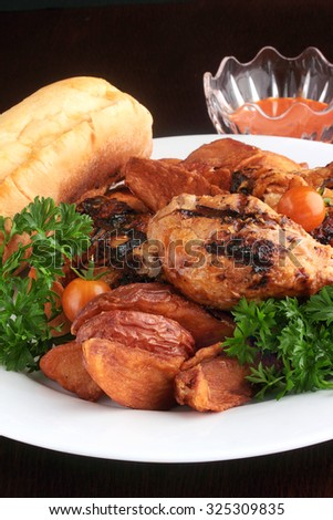 Grilled chicken dinner, something different for Thanksgiving or Christmas dinner - stock photo