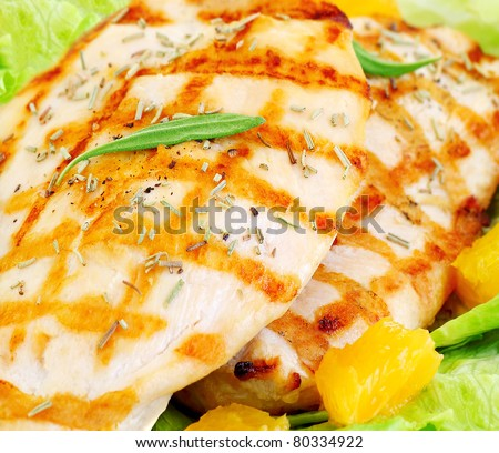 Grilled chicken fillet with rosemary and orange, tasty meal, healthy eating concept - stock photo
