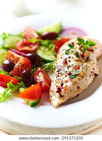 Grilled chicken fillet with salad  - stock photo