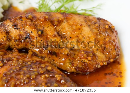 Grilled chicken fillets covered with mustard sauce. Macro. Photo can be used as a whole background.