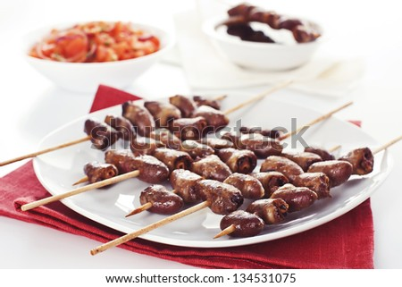 Grilled chicken hearts on skewers with soy sauce and salad. - stock ...