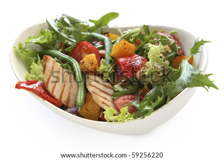 Grilled chicken in a salad with roasted vegetables.  Delicious eating! - stock photo