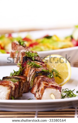 Grilled chicken kebab served with a fresh salad