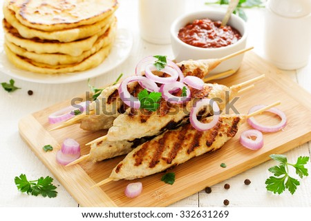 Grilled chicken kebabs. - stock photo