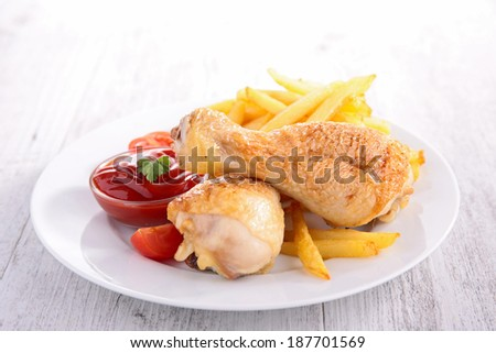 grilled chicken leg and fries
