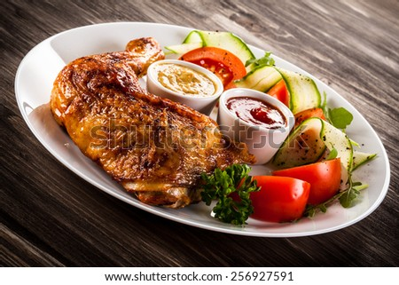Grilled chicken leg and vegetables  - stock photo