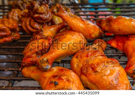 Grilled chicken leg on grill, Thailand - stock photo