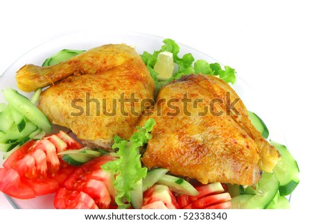 grilled chicken leg with vegetables over white