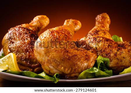 Grilled chicken legs - stock photo