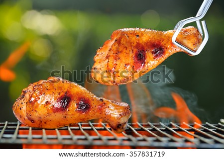 Grilled chicken Legs on the grill outdoor - stock photo