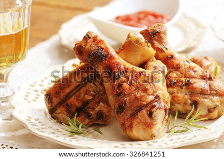 Grilled chicken legs with rosemary - stock photo