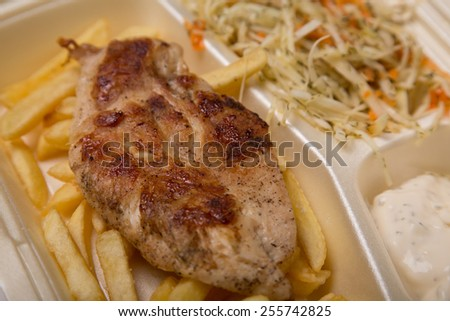 Grilled chicken meat, and French fries, soft focus  - stock photo