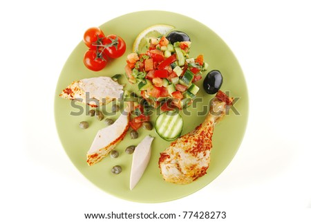 grilled chicken meat drumstick served green over white - stock photo