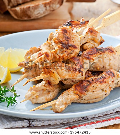 grilled chicken on bamboo skewers - stock photo