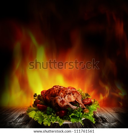 Grilled chicken over salad on the wooden desk - stock photo