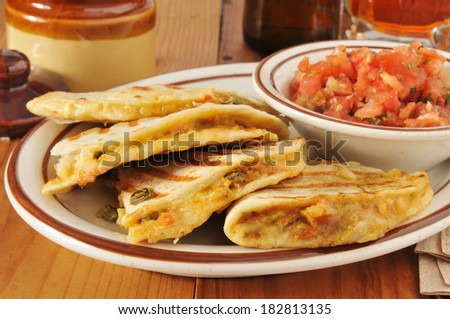 Grilled chicken quesadilla with fresh salsa - stock photo