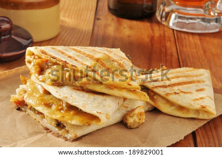 Grilled chicken quesadillas served with a mug of beer