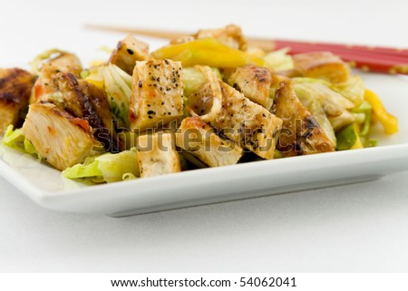 Grilled Chicken Salad with sliced Mango - stock photo