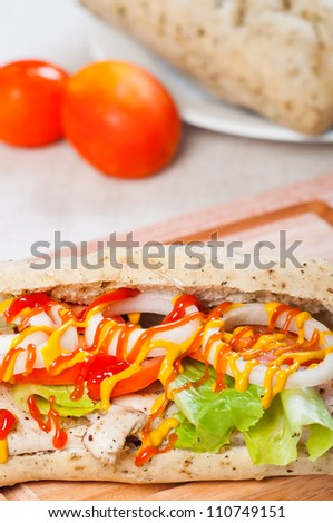 Grilled Chicken Sandwich with tomato lettuce and onion