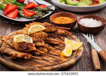 Grilled chicken skewers with lemon marinade and spices - stock photo