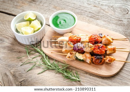 Grilled chicken skewers with zucchini and cherry tomatoes - stock photo