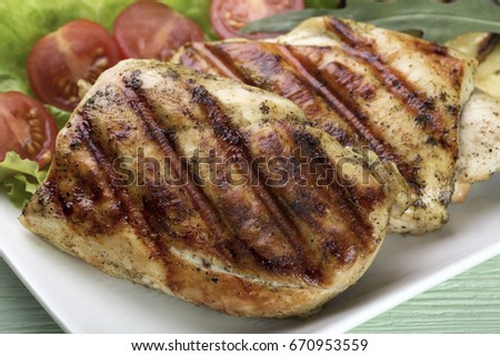 Grilled chicken steak grilled with vegetables and salad