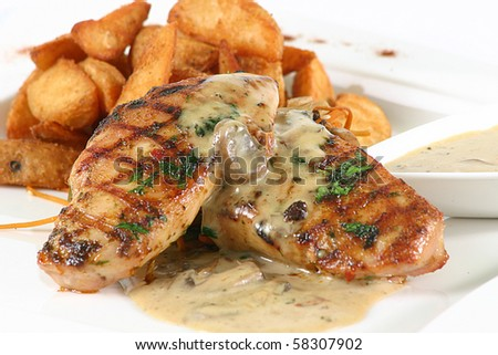Grilled Chicken Steak in mushroom's sauce & Fried Potato Wedges, on a white background - stock photo
