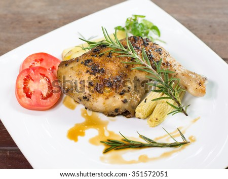 Grilled Chicken steak with black pepper, In white dish On the wooden table - stock photo