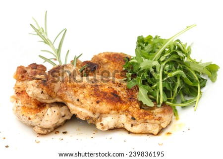 Grilled chicken steak with crispy skin and simple salad. - stock photo
