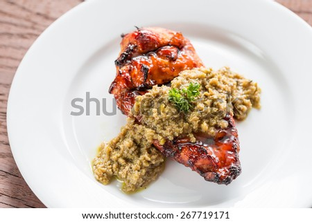 Grilled chicken steak with olive tapenade - stock photo