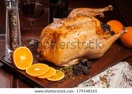 Grilled chicken stuffed with prunes and orange with red wine - stock photo