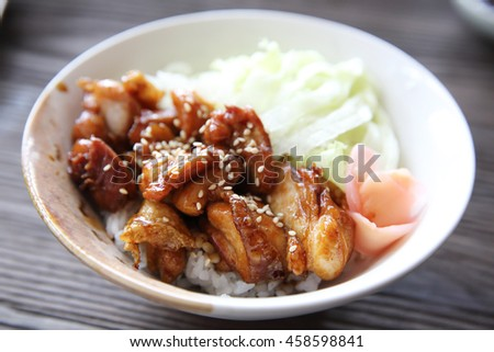 Grilled Chicken teriyaki rice on wood background , japanese food - stock photo