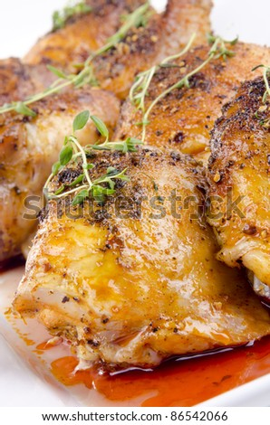grilled chicken tights with fresh thyme on a white plate - stock photo