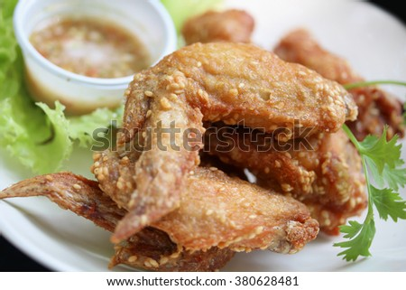 Grilled chicken wings and sesame.
