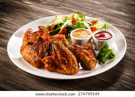 Grilled chicken wings and vegetables  - stock photo