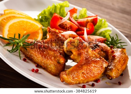 Grilled chicken wings and vegetables